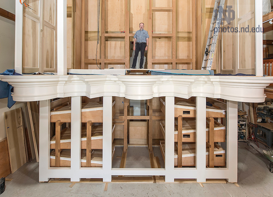 """Paul Fritts stands inside the case of the new pipe organ for the Basilica of the Sacred Heart as it appeared in July 2015. The """"set-up room"""" is the first thing visitors see when they enter the workshop at Paul Fritts & Company Organ Builders in Tacoma, Washington."""