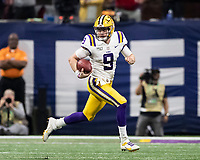 ATLANTA, GA - DECEMBER 7: Joe Burrow #9 of the LSU Tigers gets outside of the pocket for a run during a game between Georgia Bulldogs and LSU Tigers at Mercedes Benz Stadium on December 7, 2019 in Atlanta, Georgia.
