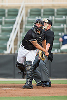 Kannapolis Intimidators catcher Seby Zavala (21) makes a throw to third base against the Augusta GreenJackets at Kannapolis Intimidators Stadium on May 3, 2017 in Kannapolis, North Carolina.  The Intimidators defeated the GreenJackets 7-4.  (Brian Westerholt/Four Seam Images)
