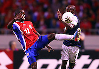 SAN JOSE, COSTA RICA - September 06, 2013: DaMarcus Beasley (7) of the USA MNT deflects a kick by Joel Campbell (12) of the Costa Rica MNT during a 2014 World Cup qualifying match at the National Stadium in San Jose on September 6. USA lost 3-1.
