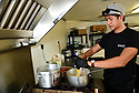 NOLA BBQeaux serves BBQ at the  Westbank Nawlins Flea Market. Sang Phan makes a sauce in the kitchen trailer.