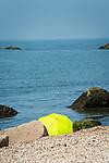 Hammonasset Beach State Park, Madison, CT. Yellow umbrella and shoreline. Long Island Sound