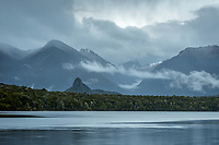 Dawn over moody Lake Manapouri with Monument, Fiordland National Park, UNESCO World Heritage Area, Southland, New Zealand, NZ