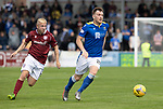 Arbroath v St Johnstone…15.08.21  Gayfield Park      Premier Sports Cup<br />Liam Craig is tracked by Nicky Low<br />Picture by Graeme Hart.<br />Copyright Perthshire Picture Agency<br />Tel: 01738 623350  Mobile: 07990 594431