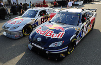 Feb 20, 2009; Fontana, CA, USA; The cars of NASCAR Sprint Cup Series driver Brian Vickers (83) and teammate Scott Speed (82) during qualifying for the Auto Club 500 at Auto Club Speedway. Mandatory Credit: Mark J. Rebilas-