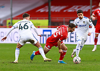 10th January 2021; Broadfield Stadium, Crawley, Sussex, England; English FA Cup Football, Crawley Town versus Leeds United; Nicholas Tsaroulla of Crawley gets through Pablo Hernández and Jamie Shackleton of Leeds united to set up scoring his goal
