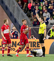 Foxborough, Massachusetts - September 22, 2018: In a Major League Soccer (MLS) match, New England Revolution (blue/white) tied Chicago Fire (red), 2-2, at Gillette Stadium.<br /> Yellow Card: Djordje Mihailovic