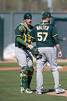 Oakland Athletics catcher Collin Theroux (55) talks to pitcher Corey Walter (57) during Spring Training Camp on February 24, 2018 at Lew Wolff Training Complex in Mesa, Arizona. (Zachary Lucy/Four Seam Images)