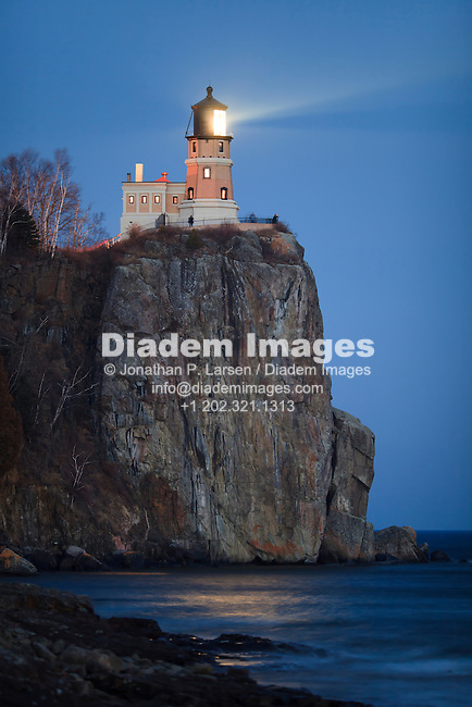 Split Rock Lighthouse shining at night.