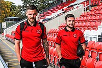 Fleetwood Town's defender Ash Eastham (5) and Joe Maguire arriving for the Sky Bet League 1 match between Fleetwood Town and Barnsley at Highbury Stadium, Fleetwood, England on 29 September 2018. Photo by Stephen Buckley / PRiME Media Images.