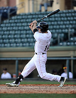 Left fielder Justin Glass (16) of the Cincinnati Bearcats in a game against the Western Carolina Catamounts on Sunday, February 24, 2013, at Fluor Field in Greenville, South Carolina. Cincinnati won in 10 innings, 7-6. (Tom Priddy/Four Seam Images)