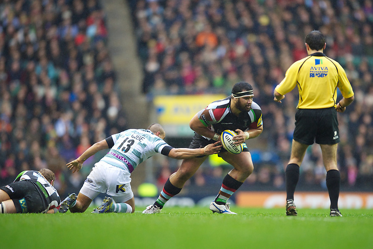 James Johnston of Harlequins escapes the tackle of Jonathan Joseph of London Irish during the Aviva Premiership match between Harlequins and London Irish at Twickenham on Saturday 29th December 2012 (Photo by Rob Munro).