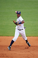 Montgomery Biscuits shortstop Hector Guevara (13) throws to first during a game against the Tennessee Smokies on May 25, 2015 at Riverwalk Stadium in Montgomery, Alabama.  Tennessee defeated Montgomery 6-3 as the game was called after eight innings due to rain.  (Mike Janes/Four Seam Images)