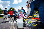 Deirdre Laide, Oakpark, filling up water from a tanker at Saint Brendan's church, Tralee on Wednesday.