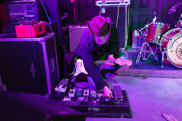 November 8, 2013. Chapel Hill, North Carolina.<br />  Guitarist Nate Soule sets up his pedal board before the show.<br />  The Mallett Bros. Band played a 2.5 hour set at the Kraken on the last leg of a 6 week tour of the US, before heading for a wedding in Maryland and then their last show in Nashville, where they will open for their father.