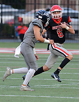 Greenwood's Colin Daggett (7), left, pursues Fort Smith Northside quarterback Walker Catsavis (6) as he carries in the first quarter on Friday, Sept. 10, 2021 in Fort Smith. (Special to NWA Democrat Gazette/Brian Sanderford)