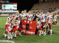 Manatee Hurricanes players including Derrick Calloway #57, Richard Baird #54, Kyle Mauk #72, Robert Morgan #73, Shawn Wilkes #67, Michael Galati #82, and Dylan Beauchamp #68 pose for a photo after the Championship trophy after the Florida High School Athletic Association 7A Championship Game at Florida's Citrus Bowl on December 16, 2011 in Orlando, Florida.  Manatee defeated First Coast 40-0.  (Mike Janes/Four Seam Images)
