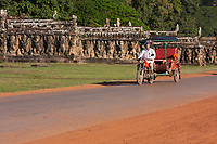Cambodia, Angkor Thom.  Motorcycle Taxi Passing the Elephant Terrace.