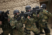 """Norwegian ISAF troops practice """"hard entry"""" at a training facility. Soldiers practice the task of apprehending people in houses. ISAF, the International Security Assistance Force, is a peacekeeping mission affiliated to the United Nations (UN) and NATO Kabul, Afghanistan."""