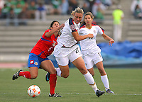 09 April 2008:  Action photo of Mary Abby Wambach (R) of United States fighting for the ball with Amanda Esquivel of Costa Rica, during game of the Womens Preolympic soccer tournament held at Ciudad Juarez. Mexico.