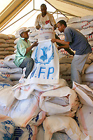 Bags of food being filled for loading on to transport planes at Logichoggio airport. The planes, operated by the United Nations World Food Programme (UN WFP), fly over Southern Sudan dropping food aid. The civil war has displaced the civilian population and created constant food shortages.