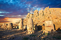 Pictures of the statues of around the tomb of Commagene King Antochus 1 on the top of Mount Nemrut, Turkey. Stock photos & Photo art prints. In 62 BC, King Antiochus I Theos of Commagene built on the mountain top a tomb-sanctuary flanked by huge statues (8–9 m/26–30 ft high) of himself, two lions, two eagles and various Greek, Armenian, and Iranian gods. The photos show the broken statues on the  2,134m (7,001ft)  mountain. 6
