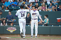 Craig Dedelow (26) of the Winston-Salem Dash is greeted at home plate by Zach Remillard (7) after hitting a 2-run home run against the Down East Wood Ducks at BB&T Ballpark on May 10, 2019 in Winston-Salem, North Carolina. The Wood Ducks defeated the Dash 9-2. (Brian Westerholt/Four Seam Images)