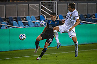 SAN JOSE, CA - SEPTEMBER 13: Nick DePuy #20 challenges Cristian Espinoza #10 of the San Jose Earthquakes during a game between Los Angeles Galaxy and San Jose Earthquakes at Earthquakes Stadium on September 13, 2020 in San Jose, California.