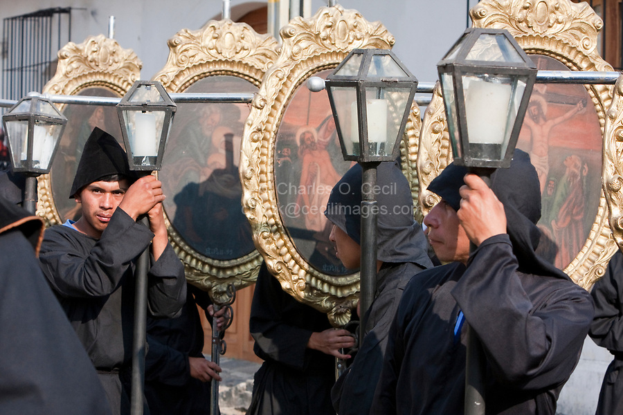 Antigua, Guatemala.  Holy Saturday.  Nazarenos Carrying Pictures of the Stations of the Cross in the Procession of the Virgin of Solitude (Virgen de Soledad), Holy Week, La Semana Santa.