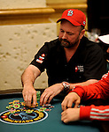 PS Team Pro Dennis Phillips rakes in a big pot after eliminating a player.