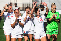MONTCLAIR, NJ - OCTOBER 03: Katie McClure #6 of the Washington Spirit, Meggie Dougherty Howard #8 of the Washington Spirit, Devon Kerr #25 of the Washington Spirit along with teammates wave to fans in a nearby parking garage post-game after a game between Washington Spirit and Sky Blue FC at Pittser Field on October 03, 2020 in Montclair, New Jersey.
