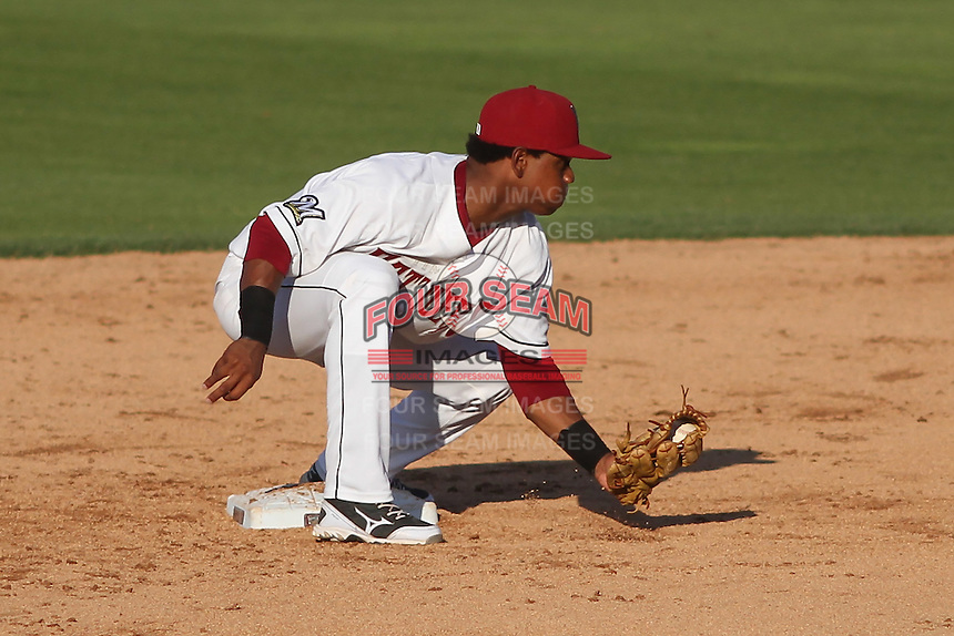 Wisconsin Timber Rattlers second baseman Gregory Munoz (7) waits to apply a tag during a Midwest League game against the Quad Cities River Bandits on July 17th, 2015 at Fox Cities Stadium in Appleton, Wisconsin. Quad Cities defeated Wisconsin 4-2. (Brad Krause/Four Seam Images)