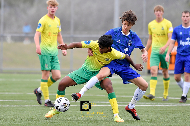Noah Karunaratne of Lower Hutt AFC competes for the ball Oliver Pickering of Petone FC during the Central League Football - Petone FC v Lower Hutt AFC at Petone Memorial Park, Lower Hutt, New Zealand on Friday 2 April 2021.<br /> Copyright photo: Masanori Udagawa /  www.photosport.nz