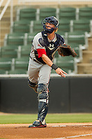 Greenville Drive catcher Jordan Weams (18) makes a throw to third base against the Kannapolis Intimidators at CMC-Northeast Stadium on June 29, 2013 in Kannapolis, North Carolina.  The Intimidators defeated the Drive 9-3 in the completion of the game that began on June 28, 2013.   (Brian Westerholt/Four Seam Images)