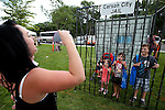 Holly Roel takes a photo of, from left, Elijah Roel, 1, Addie Fisher, 2, Nevaeh Kaylor, 5 and Aiden Pope, 9, during the 11th annual National Night Out hosted by the Carson City Sheriff's Office in Carson City, Nev., on Tuesday, Aug. 6, 2013. <br /> Photo by Cathleen Allison