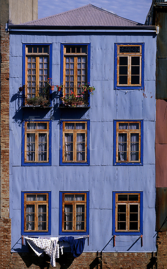 COLORFULLY painted home in historic CERRO CONCEPTION with blue metal siding - VALPARAISO, CHILE
