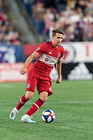 FOXBOROUGH, MA - AUGUST 25: Przemyslaw Frankowski #11 of Chicago Fire looks to pass during a game between Chicago Fire and New England Revolution at Gillette Stadium on August 24, 2019 in Foxborough, Massachusetts.