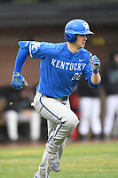 Right fielder Ryan Johnson (28) of the Kentucky Wildcats runs out a batted ball in a game in the rain against the University of South Carolina Upstate Spartans on Saturday, February 17, 2018, at Cleveland S. Harley Park in Spartanburg, South Carolina. Kentucky won, 6-5, in 10 innings. (Tom Priddy/Four Seam Images)