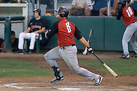 August 14, 2007: Catcher Tyler LaTorre of the Salem-Keizer Volcanoes follows through after making contact with a pitching during a Northwest League game against the Everett AquaSox at Everett Memorial Stadium in Everett, Washington.