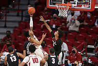 Arkansas guard Desi Sills (3) shoots as Georgia Justin Kier (5) blocks, Saturday, January 9, 2021 during the second half of a basketball game at Bud Walton Arena in Fayetteville. Check out nwaonline.com/210110Daily/ for today's photo gallery. <br /> (NWA Democrat-Gazette/Charlie Kaijo)