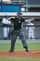 Home plate umpire Brandon Blome calls a batter out on strikes during the Appalachian League game between the Kingsport Mets and the Burlington Royals at Burlington Athletic Stadium on July 18, 2016 in Burlington, North Carolina.  The Royals defeated the Mets 8-2.  (Brian Westerholt/Four Seam Images)