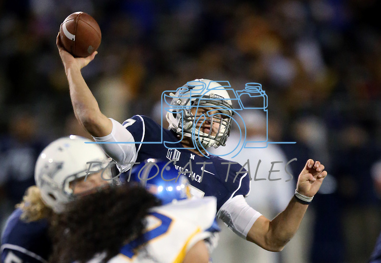 Nevada's quarterback Cody Fajardo plays in an NCAA college football game against San Jose State, in Reno, Nev., on Saturday, Nov. 16, 2013. (AP Photo/Cathleen Allison)