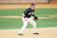 Wake Forest Demon Deacons shortstop Conor Keniry (14) on defense against the Florida State Seminoles at Wake Forest Baseball Park on April 19, 2014 in Winston-Salem, North Carolina.  The Seminoles defeated the Demon Deacons 4-3 in 13 innings.  (Brian Westerholt/Four Seam Images)