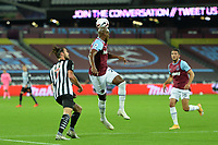 Angelo Ogbonna of West Ham United heads clear under pressure from Andy Carroll of Newcastle United during West Ham United vs Newcastle United, Premier League Football at The London Stadium on 12th September 2020