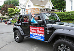 NAUGATUCK, CT - 26 MAY - 052818JW01.jpg --  Air Force veteran Manuel Matos waves to the crowds as the Naugatuck Memorial Day Parade Grand Marshall Monday morning. Jonathan Wilcox Republican-American
