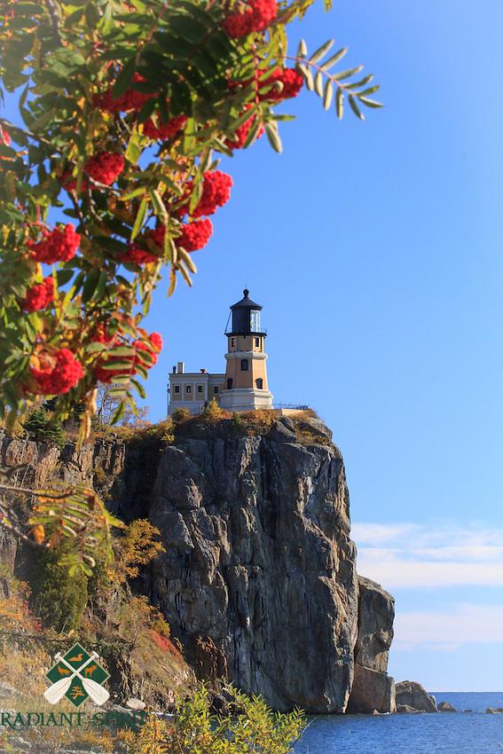 Mountain Ash berries frame the historic Split Rock Lighthouse in Autumn.