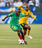 CARSON, CA – June 6, 2011: Greneda player Patrick Modeste (19) attempts to keep the ball from Jamaican Luton Shelton (21) during the match between Grenada and Jamaica at the Home Depot Center in Carson, California. Final score Jamaica 4 and Grenada 0.