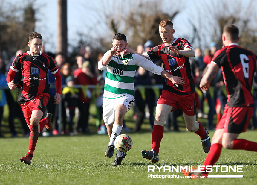 FAI Junior Cup Quarter Final.<br /> Peake Villa v Sheriff YC<br /> Tower Grounds,<br /> Thurles, Co Tipperary<br /> Sunday 12th March 2017<br /> Sean Murphy (Sheriff YC) in action against Matthew Fogarty (Peake Villa)  <br /> Photo Credit: Michael P Ryan