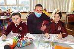 Enjoying their first day back at school in Muire gan SmálNational School Castleisland on Monday. L to r; Ryan Whelan, Donal Gorman (Teacher) and Paris Coffey.