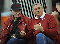 NWA Democrat-Gazette/ANDY SHUPE - Former Arkansas coaches John McDonnell (left) and Dick Booth speak during the Tyson Invitational Saturday, Feb. 14, 2015, at the Randal Tyson Track Center in Fayetteville.